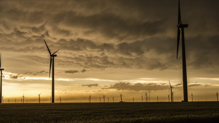 Mammatus clouds gather over a wind farm in rural Kansas.