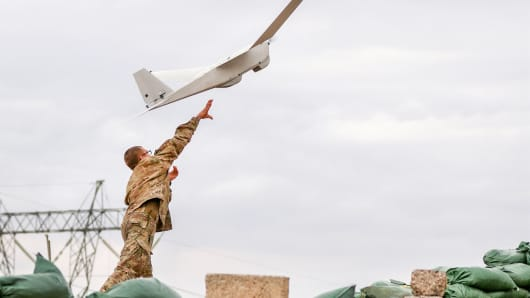 U.S. Army soldier launches AeroVironment's Puma unmanned aerial vehicle during an Iraqi security forces' offensive on an ISIS position near the western edge of Mosul, Iraq, March 19, 2017.