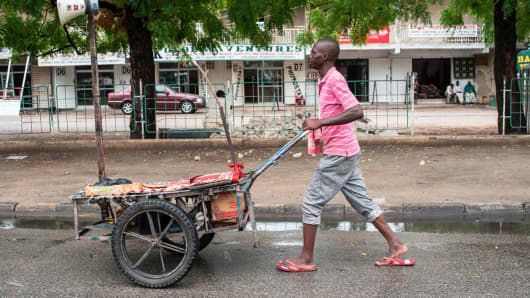 A man pushes a cart with a megaphone playing Islamic verses in the street of Maiduguri in north-east Nigeria on July 5, 2017.