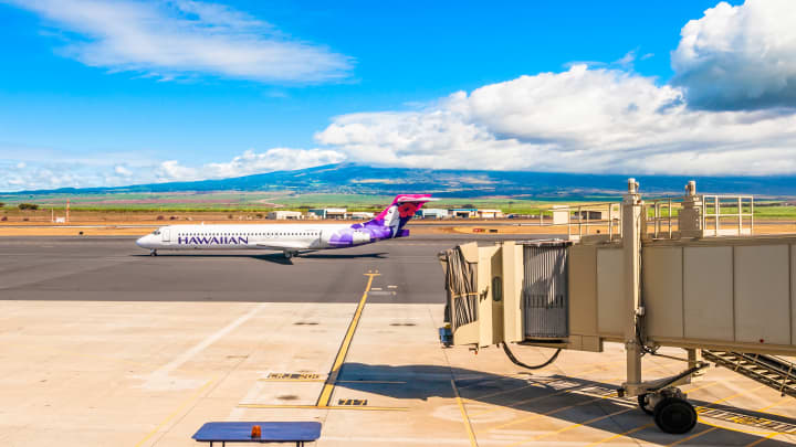 Hawaiian Airline Boeing 717-200 on the tarmac of Kahului Airport in Maui, Hawaii.
