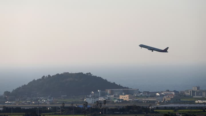 An Asiana Airlines passenger aircraft takes off from Jeju International Airport in Jeju, South Korea.