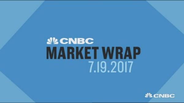 Key earnings reports push stocks to record highs