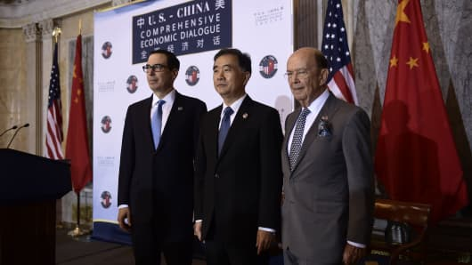 US Treasury Secretary Steven Mnuchin, Chinese Vice Premier Wang Yang and US Commerce Secretary Wilber Ross at the U.S.-China Comprehensive Economic Dialogue in Washington, DC. on July 19, 2017.