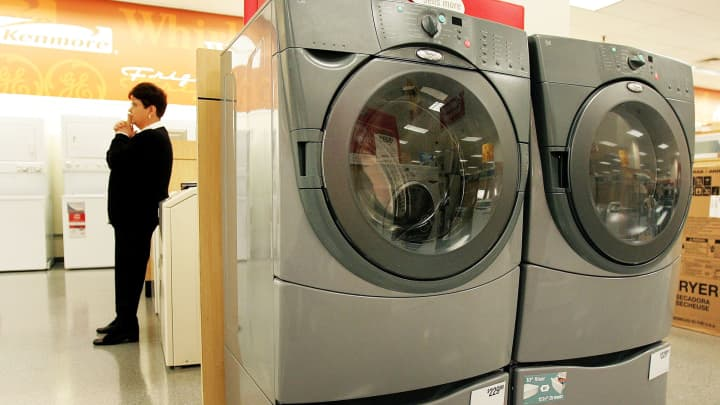 Washer and dryer appliances in a Sears store.