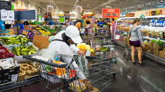 Customers browse produce of the Lidl Ltd. store in Virginia Beach, Virginia.
