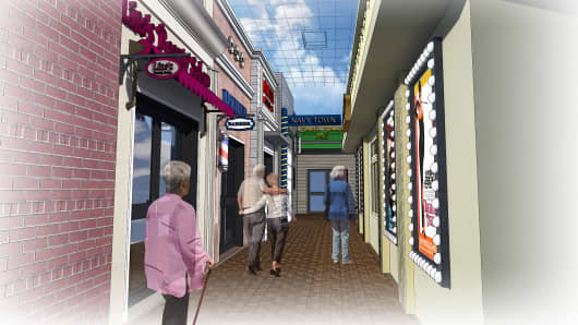 A rendering of the Gaslamp district of Glenner Town Square. The retro town, outfitted with gas-lit streetlamps, has props, sounds and smells to reflect a person's younger years.