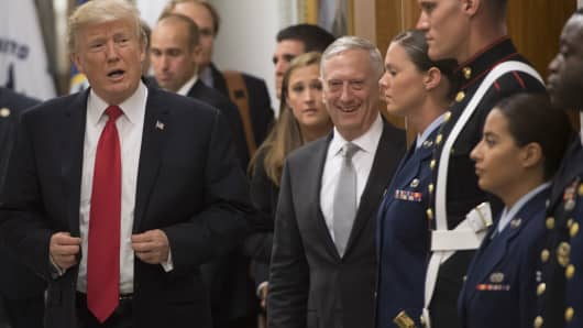President Donald Trump greets members of the US military alongside Defense Secretary James Mattis (C) following a meeting at the Pentagon in Washington, DC, July 20, 2017.