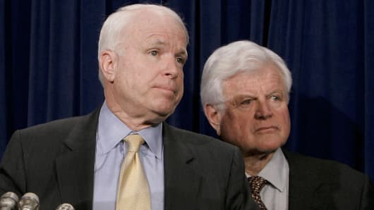 Sen. Edward Kennedy (D-MA) (L) and U.S. Sen. John McCain (R-AZ) take questions during a news conference on immigration reform on Capitol Hill, on Capitol Hill, March 30, 2006 in Washington DC.