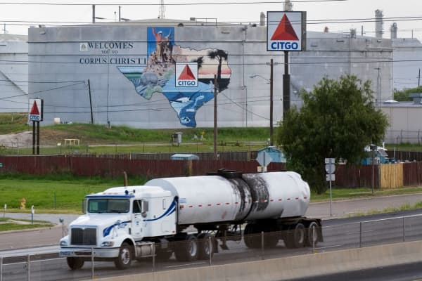 An oil tanker passes storage tanks at the Citgo Refinery in Corpus Christi, Texas.