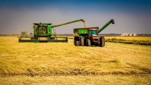 A combine harvesting rice in the California's Sacramento Valley.