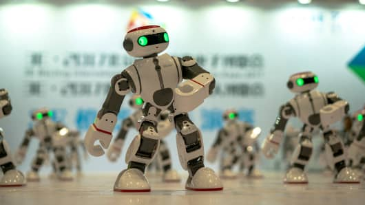 Robots dance for the audience on the expo. On Jul. 8th, Beijing International Consumer electronics Expo was held in Beijing China National Convention Center.