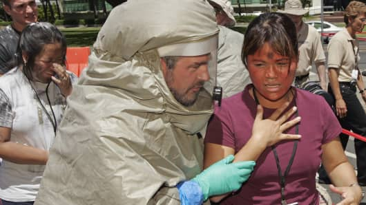 File photo of an ER tech escorting a victim of a mock nuclear blast into the decontamination tent during a disaster drill at Queen's Medical Center in Honolulu, Hawaii.