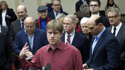 David Desjardins of Burlingame, California, is backed by fellow members of the Patriotic Millionaires as he speaks at the Capitol in Washington, D.C.