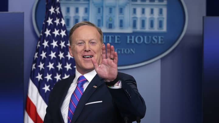 White House Press Secretary Sean Spicer waves as he leaves after a daily press briefing at the James Brady Press Briefing Room February 14, 2017 at the White House in Washington, DC.