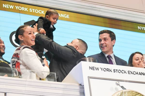 DJ Khaled, his wife and son visit the New York Stock Exchange opening bell.