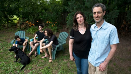 Leah Gomberg, a home stager, and her husband, David, a self-employed psychologist, with their family in Maplewood, N.J., June 29, 2017.