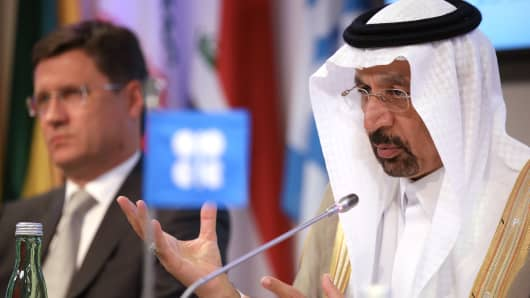 Khalid Bin Abdulaziz Al-Falih, Saudi Arabia's energy minister and president of OPEC, speaks as Alexander Novak, Russia's energy minister, left, listens during a news conference following the 172nd Organization of Petroleum Exporting Countries (OPEC) meeting in Vienna, Austria, on Thursday, May 25, 2017.