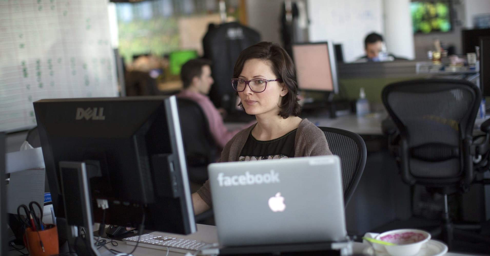Employees at Facebook are seen working inside the office at Facebook Inc.'s European headquarters at Hanover Quay in Dublin, Ireland.
