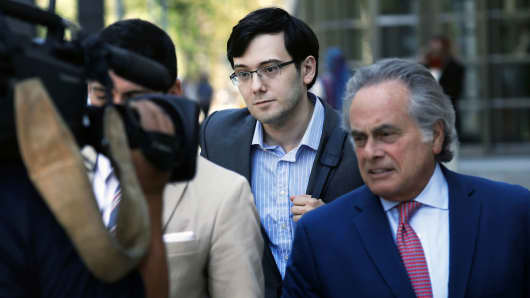 Martin Shkreli, former chief executive officer of Turing Pharmaceuticals AG, center, exits federal court with his attorney Benjamin Brafman, right, in the Brooklyn, New York, July 21, 2017.