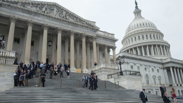 Lawmakers walk out of the US Capitol in Washington, DC.