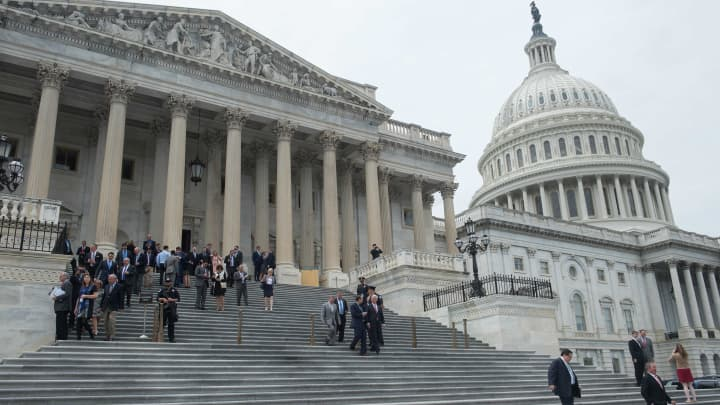 Lawmakers walk out of the US Capitol in Washington, DC, on May 4, 2017 after the House of Representatives narrowly passed a Republican effort to repeal and replace Obamacare, delivering a welcome victory to President Donald Trump after early legislative stumbles.