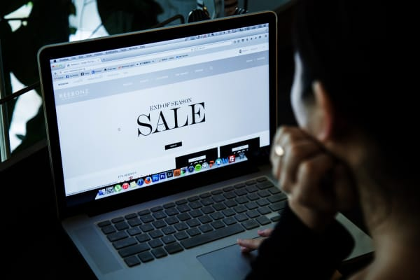 A shopper browses the internet for deals.