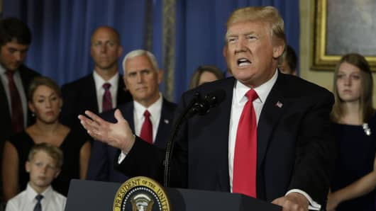 President Donald Trump delivers a statement on healthcare in front of alleged 'victims of Obamacare' at the White House in Washington on July 24, 2017.
