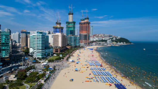Buildings stand under construction on Haeundae beach in Busan, South Korea, on Sunday, July 16, 2017.