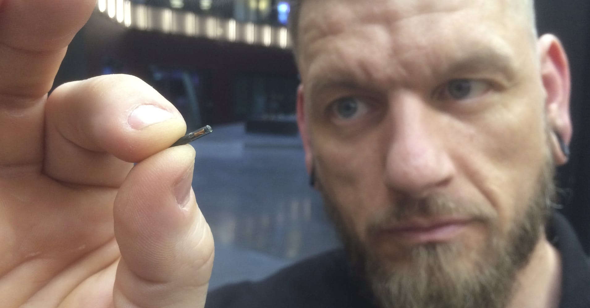 Jowan Osterlund of Biohax with one of the company's implantable microchips. Three Square Market, a company in Wisconsin, is partnering with Biohax to offer the chips to employees. Credit