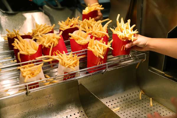 A McDonald's crew member prepares french fries in Miami, Florida.