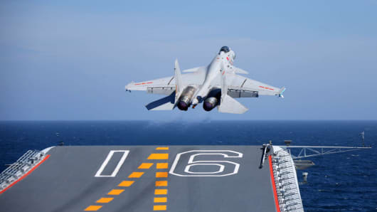 A J-15 fighter jet takes off from aircraft carrier Liaoning during a training on July 1, 2017 in China.