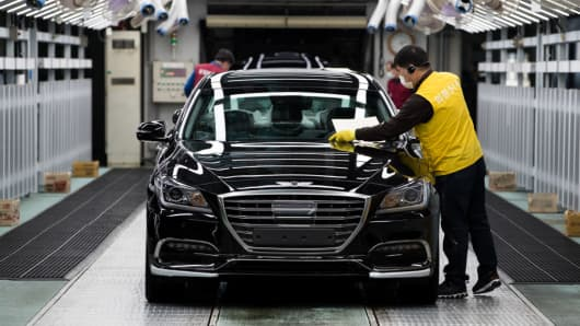 An employee inspects a Hyundai Motor Genesis sedan on the production line at the company's plant in Ulsan, South Korea, on Monday, April 24, 2017.