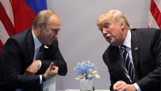 Russia's President Vladimir Putin (L) and US President Donald Trump talking during a bilateral meeting on the sidelines of the G20 summit in Hamburg.