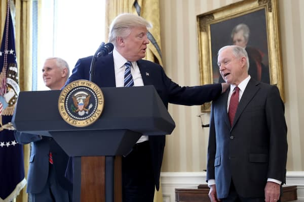 President Donald Trump puts his hand on the shoulder of Sen. Jeff Sessions after introducing him before Sessions's swearing in ceremony in the Oval Office of the White House February 9, 2017 in Washington, DC.