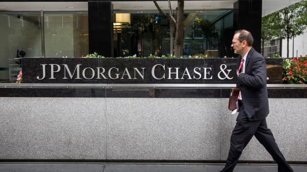 A man walks past JP Morgan Chase's corporate headquarters.