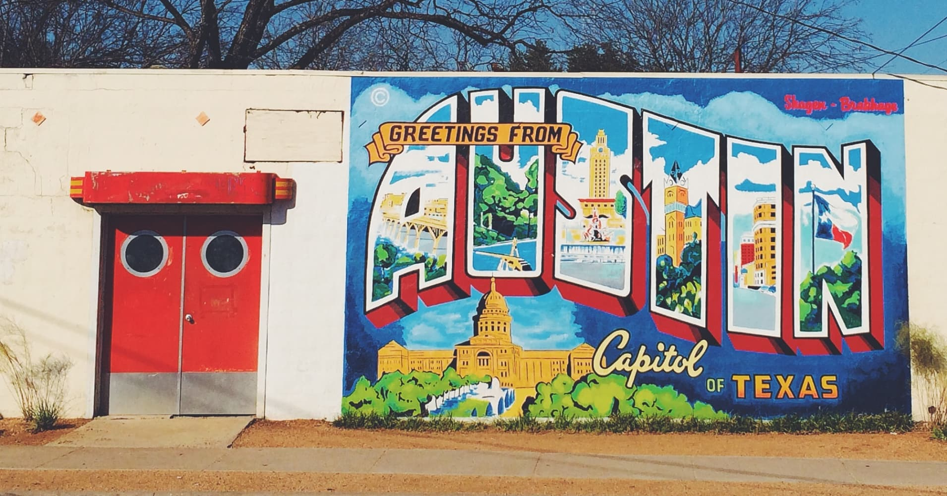 """Greetings from Austin"" street art mural."