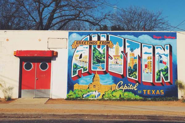 """Greetings from Austin"" street art mural."