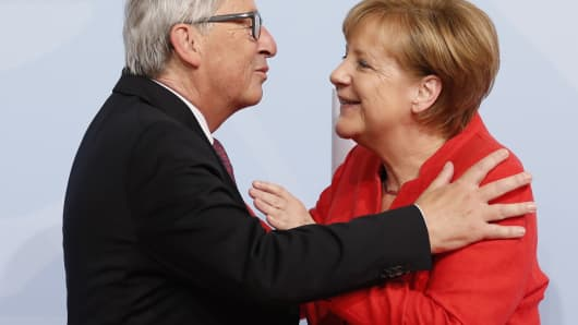 German Chancellor Angela Merkel officially welcomes President of the European Commission Jean-Claude Juncker to the opening day of the G20 summit on July 7, 2017 in Hamburg, Germany