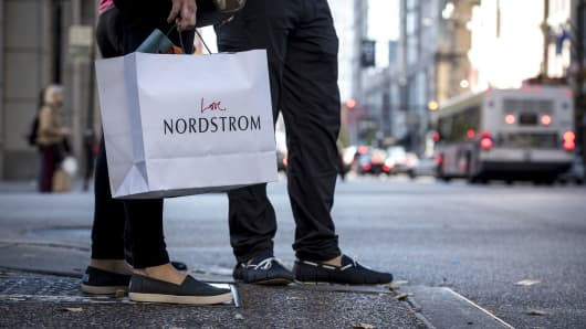 A pedestrian carries a Nordstrom shopping bag in Chicago.