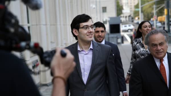 Martin Shkreli, former chief executive officer of Turing Pharmaceuticals AG, left, arrives at federal court with his attorney Benjamin Brafman, right, in the Brooklyn borough of New York, U.S., on Thursday, July 27, 2017. Prosecutors wrapped up their fraud case against Shkreli after weeks of testimony that depicted the Retrophin Inc. co-founder as a Ponzi schemer who stole money from h
