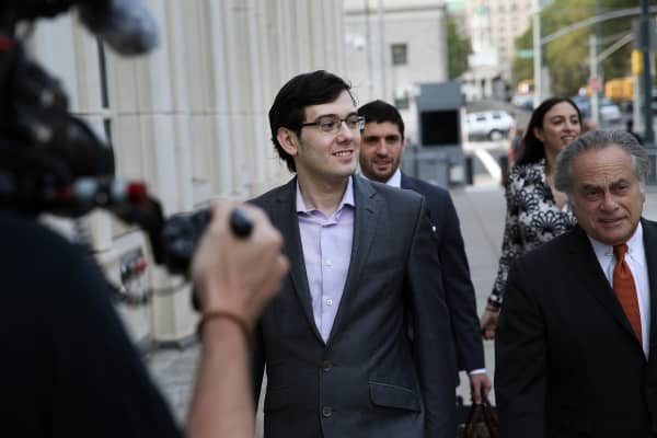 Martin Shkreli, former chief executive officer of Turing Pharmaceuticals AG, left, arrives at federal court with his attorney Benjamin Brafman, right, in the Brooklyn borough of New York, U.S., on Thursday, July 27, 2017. Prosecutors wrapped up their fraud case against Shkreli after weeks of testimony that depicted the Retrophin Inc. co-founder as a Ponzi schemer who stole money from his hedge-fund investors to launch his drug company.