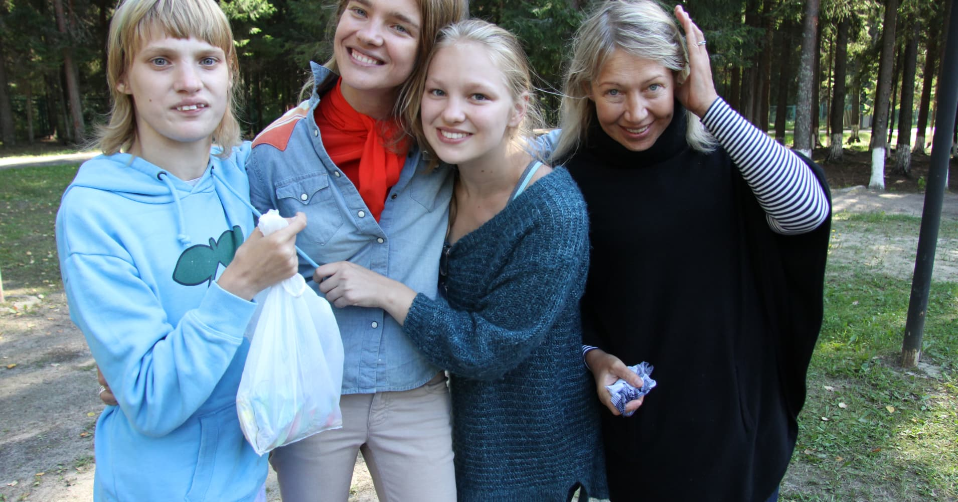 Natalia Vodianova (second left) with half sisters Oksana (left) and Kristina (right) and mother Larisa (far right)