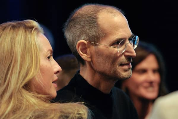 Steve Jobs, co-founder and chief executive officer of Apple Computer Inc., greets attendees his wife, Laurene Powell Jobs, after delivering the keynote address at the Apple World Wide Developers Conference in 2011.