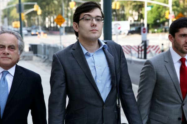 Martin Shkreli, former chief executive officer of Turing Pharmaceuticals AG, center, arrives at federal court with his attorney Benjamin Brafman, left, in the Brooklyn borough of New York, U.S., on Friday, July 28, 2017.