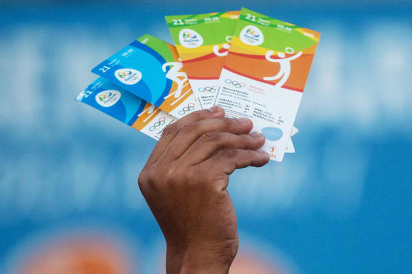 A man holds up tickets outside a venue of the Rio 2016 Olympic Games last year.