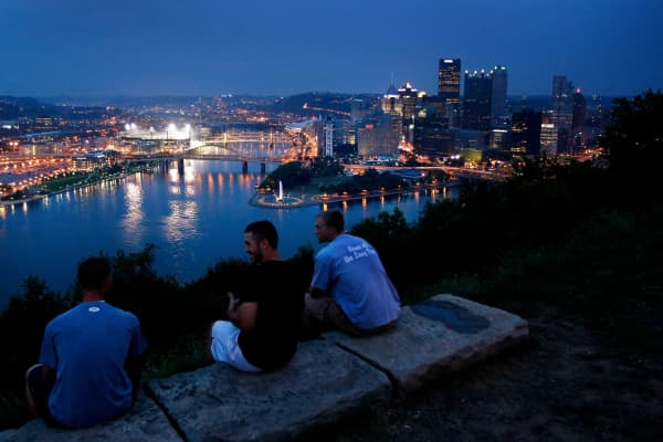 Residents sit atop Mount Washington while overlooking downtown Pittsburgh