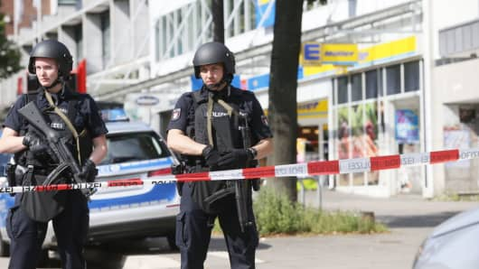 Police cordon off the area around a supermarket in the northern German city of Hamburg, where a man killed one person and wounded several others in a knife attack, on July 28, 2017 .