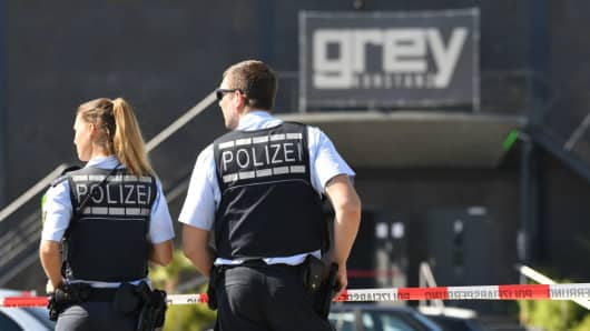 Police stand in front of the disco Club Grey in the southern German town of Konstanz, where a gunman opened fire, killing one and wounding four people before being shot by police, on July 30, 2017.