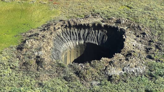 This photograph shows a crater on the Yamal Peninsula, northern Siberia, taken on August 25, 2014. Its formation is possibly linked to climate change.