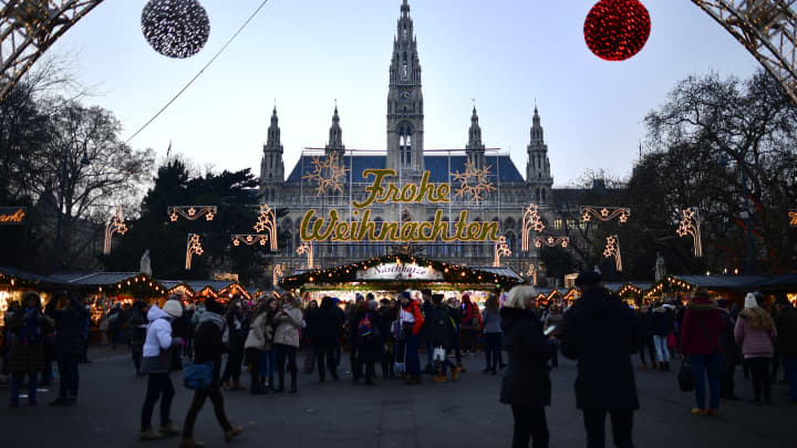 The christmas market at the town hall of Vienna is seen during sunset on December 5, 2016 in Vienna, Austria.
